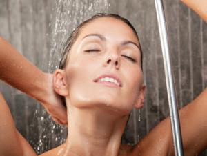 girl in the shower rinsing her hair