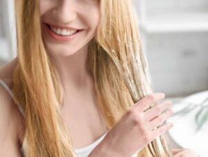 girl applying mask on her hair